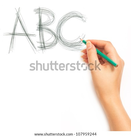 Woman's hand holding a pencil and writing ABC alphabet on a white white background