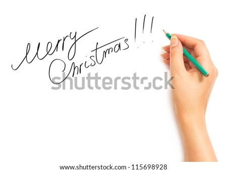 Woman's hand holding a pencil and writing Merry Christmas on a white background - stock photo