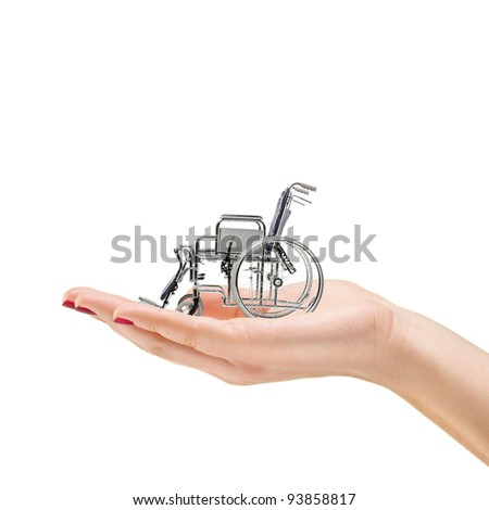 Woman's hand holding a wheelchair, isolated on white background