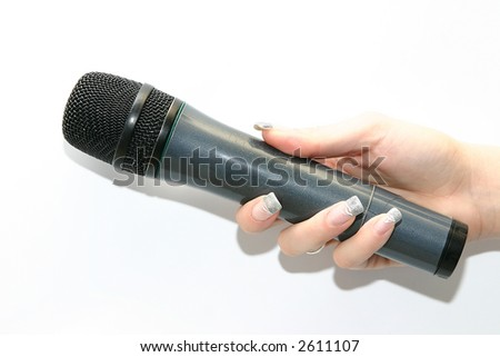 woman's hand holding black microphone isolated on white