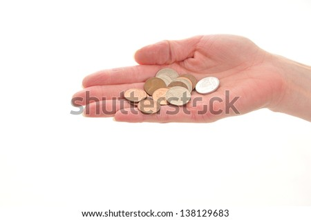 woman's hand holding English coins isolated on white background