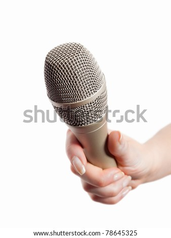Woman's hand holding microphone isolated on white