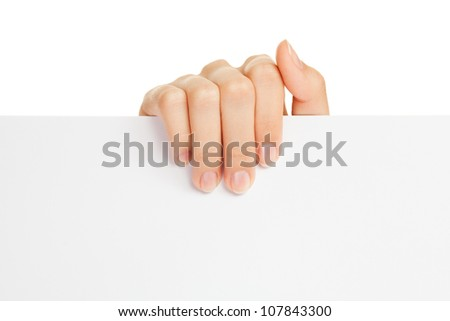 Woman's hand holding paper on white background - stock photo