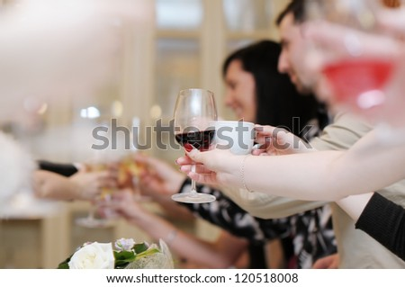 Woman's hand holding wine glass at festive event