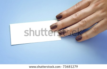 Woman's hand keeping a card on a blue background