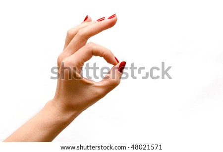 Woman's hand making sign Ok isolated on white background - stock photo