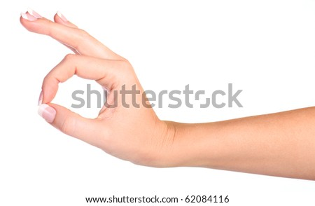 Woman's hand making sign Ok isolated on white background