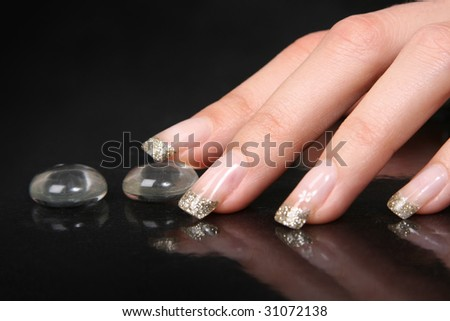 woman's hand on black background