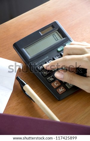 woman's hand open on calculator