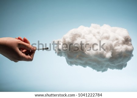 Woman's hand plugging a wire into a white cloud. Digital data storage. Cloud uploading. Stock photo ©