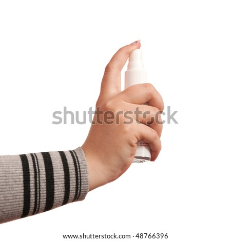 Woman's hand pressing aerosol; isolated on the white background