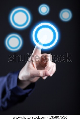 Woman\'s hand pushing the button on touch screen. Choice concept