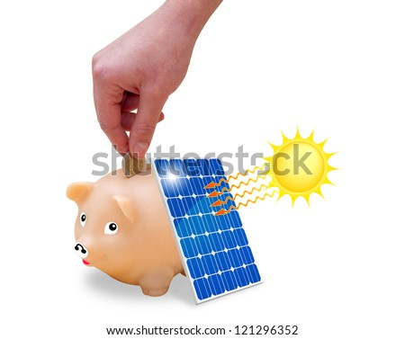 Woman's hand putting money saved in a piggy bank