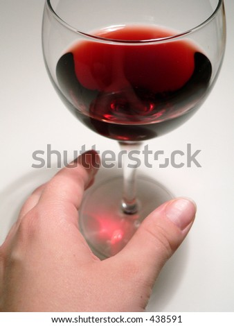 Woman's hand reaching for Wine Glass
