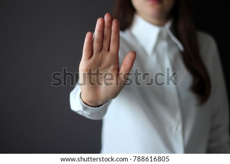 Woman's Hand Showing Reject, Stop, Break, Pause Gesture