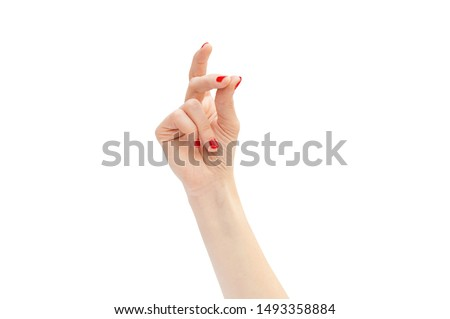 Photo of  Woman's hand snapping by fingers. Isolated on white.