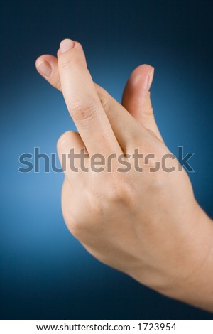 woman's hand with crossed fingers