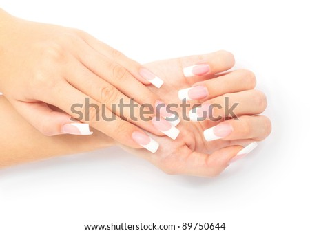 Woman's hand with French manicure on white background