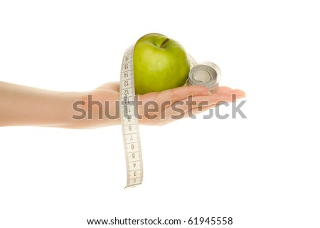 Woman's hand with green apple and tape measure isolated on white