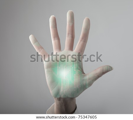 Woman's hand with microchip in it
