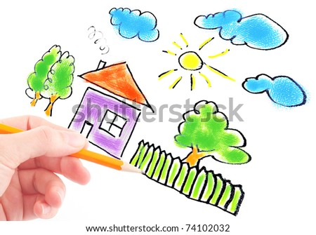 woman's hand with the pencil and brushes drawing the dream home on a white sheet of paper