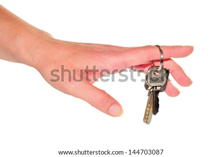 woman's hand with two keys in the finger