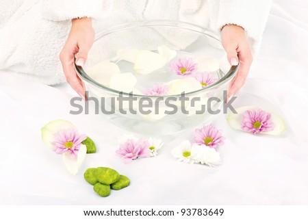 Woman's hands and petal bath