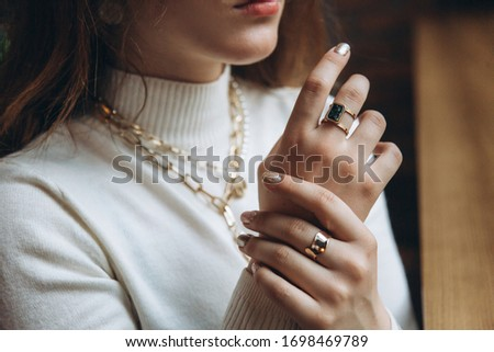 Woman's hands close up wearing rings and necklace modern accessories elegant lifestyle 2020 Photo stock ©