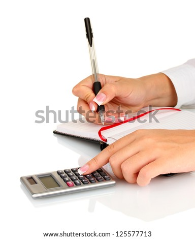 Woman's hands counts on the calculator, on white background close-up