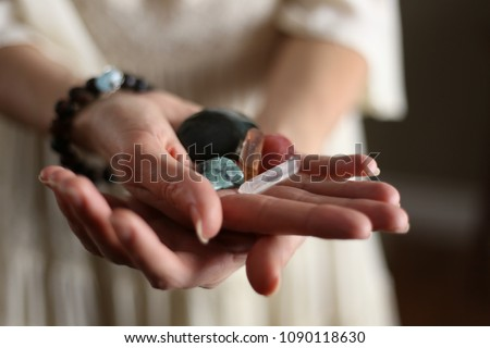 Woman's hands hold magic healing crystals. #1090118630