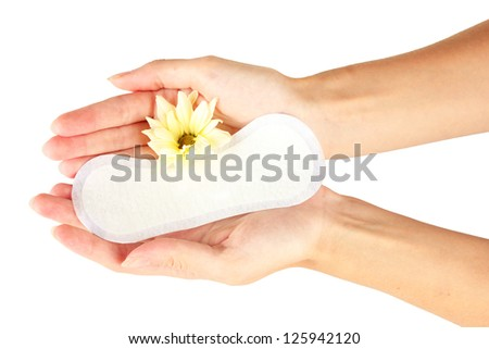 woman\'s hands holding a daily sanitary pad on white background close-up