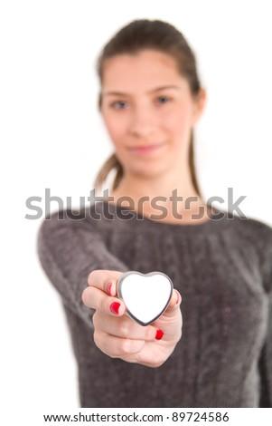 Woman's hands holding a metal heart