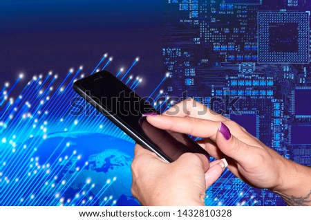 Woman's hands holding a mobile phone world background and circuits #1432810328