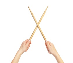 Woman's hands holding drum sticks. Isolated on white.