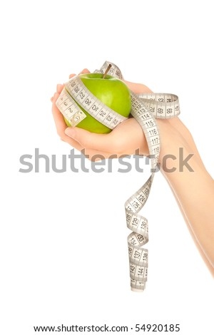 Woman's hands holding green apple with measuring tape isolated