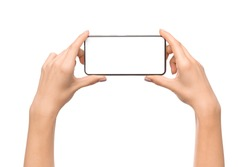 Woman's hands holding smartphone with blank screen in horizontal orientation, watching videos. Isolated on white background