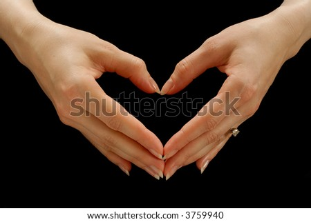 Woman's hands making the shape of a heart