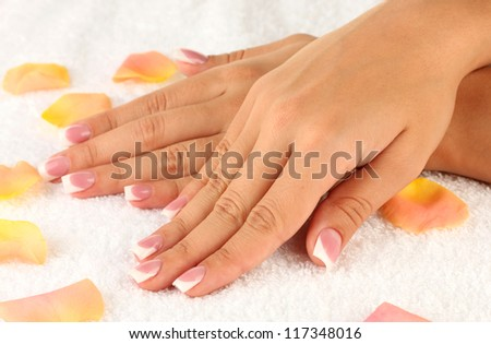 woman's hands on white terry towel, close-up