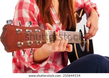 woman's hands playing acoustic guitar, close up. Isolated over white background