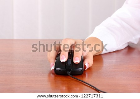 woman's hands pushing keys of pc mouse, close-up