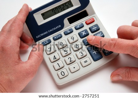 Woman´s hands using an electronic  calculator, close-up, isolated on white