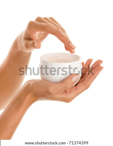 Woman's hands with body lotion