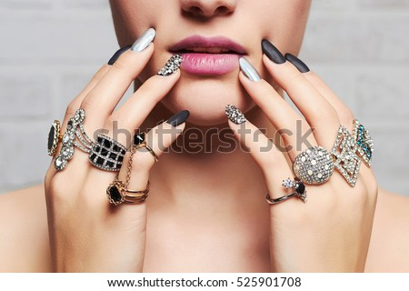 woman\'s hands with jewelry rings.close-up beauty and fashion portrait. girl make-up and manicure