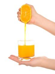 Woman's hands with orange fresh juice