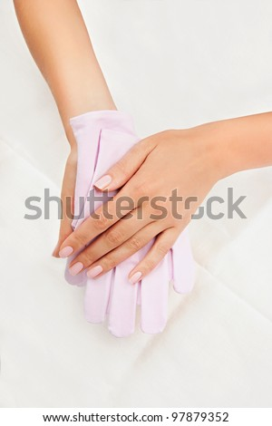 Woman's hands with Reviving Gloves