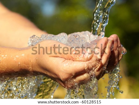 Woman\'s hands with water splash