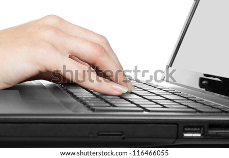 Woman's hands working on notebook keyboard on white background