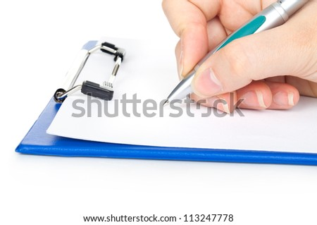 Woman's hands writing on blank sheet of paper in a clipboard and a pen; isolated on white