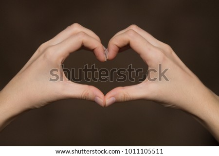 woman's heart-shaped hands as a symbol of love #1011105511