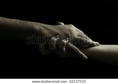 Woman´s initiative. Woman´s hand grabbing man´s hand. Image in low-key. #22137535